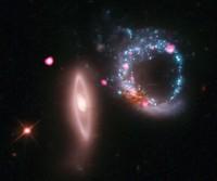 Chandra ziet ring van zwarte gaten in Arp 147