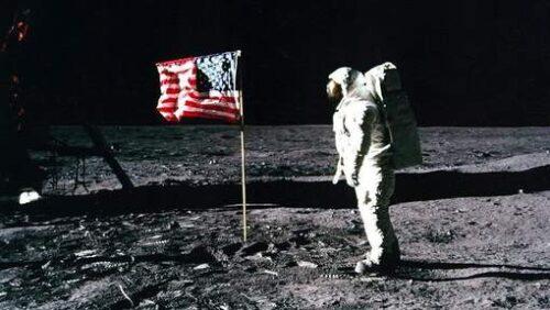 Neil Armstrong near US flag on the moon