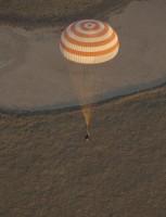 Drie ISS-astronauten teruggekeerd op aarde mét olympische fakkel