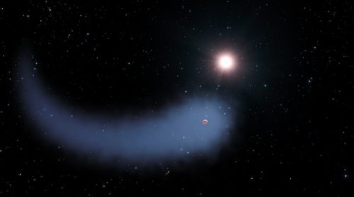 This artist's concept shows the enormous comet-like cloud of hydrogen bleeding off of the warm, Neptune-sized planet Gliese 436b just 30 light-years from Earth. Also depicted is the parent star, which is a faint red dwarf named Gliese 436. The hydrogen is evaporating from the planet due to extreme radiation from the star. A phenomenon this large has never before been seen around any exoplanet.